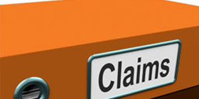 orange binder labeled with the word claims